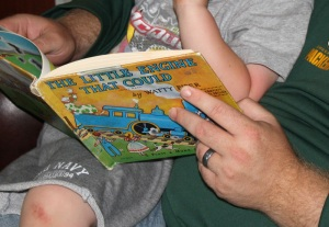 Joe reading to Jackson before dinner.  In 1980 this copy was given to Jackson's mother (my older daughter) by my parents.  My parents gave a different copy to me in 1960.