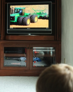 Watching the All About John Deere for Kids 4-DVD set.