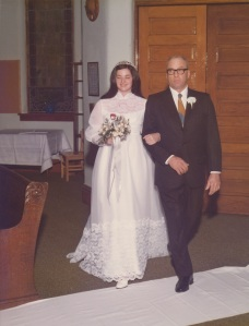 "My father and me (Louise) on November 15, 1975.  I purposely did not crop closely in case anyone wanted to ""relive"" a visual of Rolfe's Presbyterian Church.  The last service held in this church was its Commemorative Sunday, April 30, 1995.  (Click photo to enlarge.)"